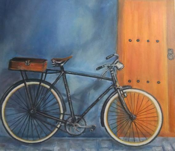 Bicicleta sobre fondo azul