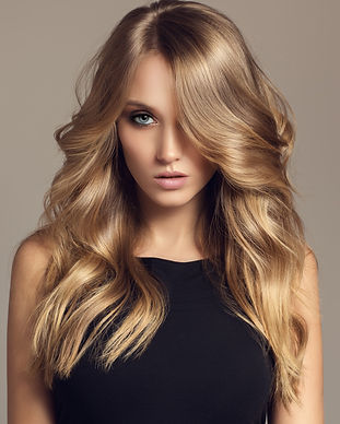 Blond%20woman%20with%20long%20curly%20be