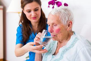 Kind Caregiver Helping.jpg