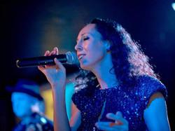 Etel Singing Closeup_Peter Koutun, photo