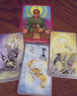 Excerpt from December's 3 card reading (plus the oracle card I previously pulled). There are some de