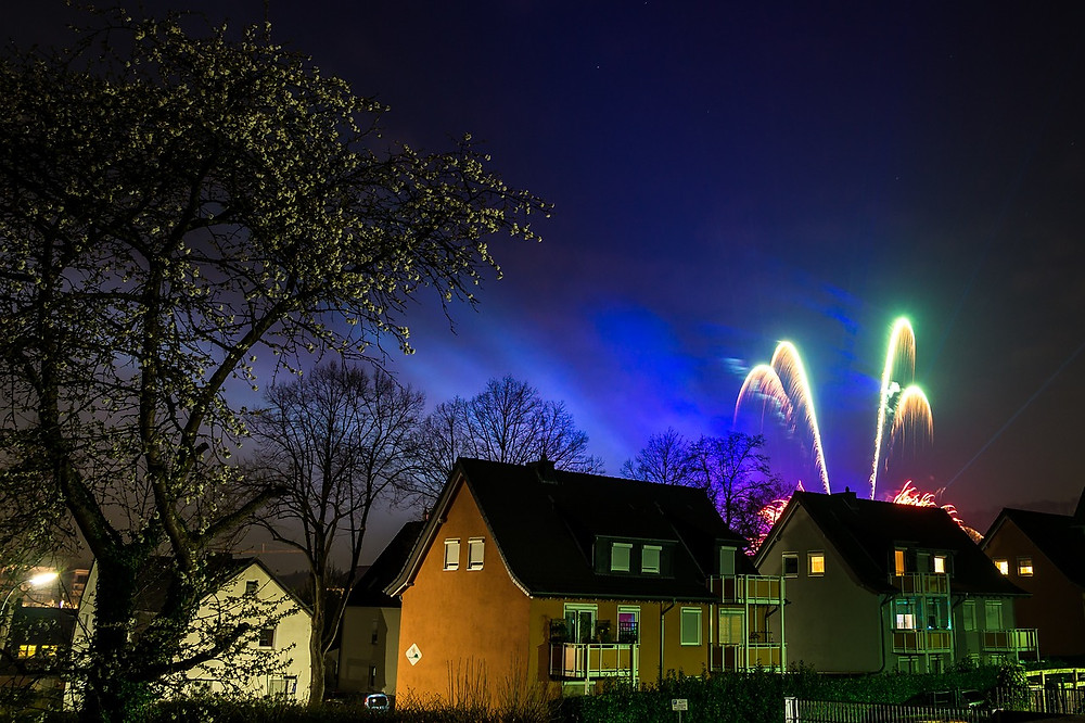 Fireworks going off behind house