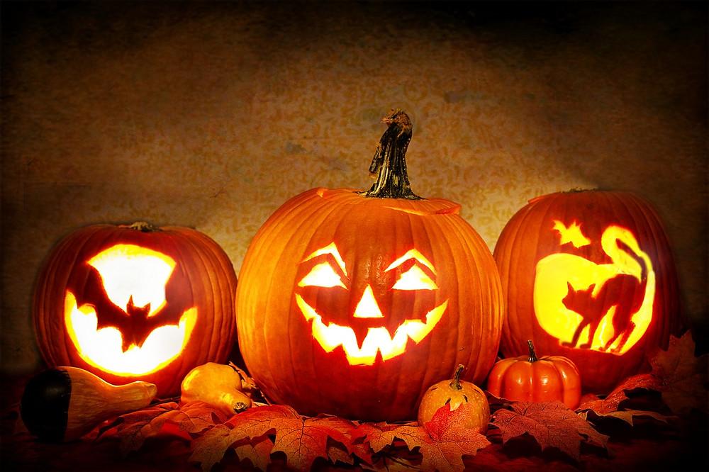 Carved, lit pumpkins