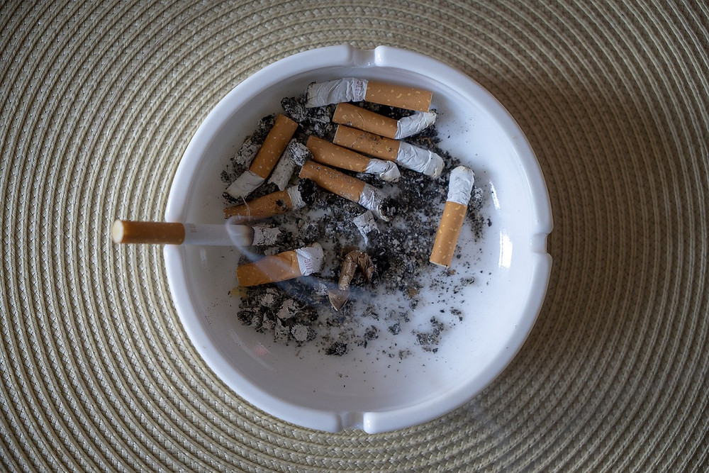 Ashtray containing a number of cigarette butts