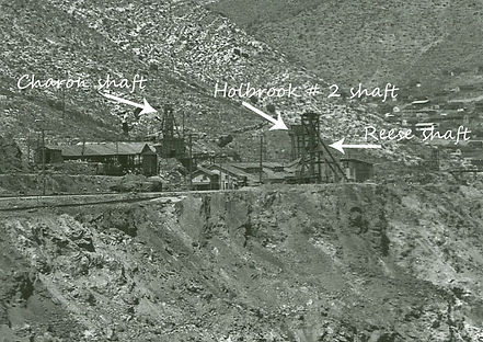 A slightly confusing photo of four mine headframes, on the left is the Charon, then the Reese shaft still with a tiny hoist house, with the Holbrook #2 mine immediately behind the Reese. A fourth headframe of an unknown shaft can faintly be seen on the ri