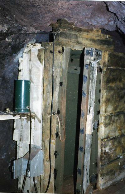 Cap magazine inside the Shattuck mine  with spitter can on shelf
