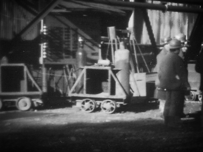 Two acetylene cars at the collar of the Cole Shaft  in South Bisbee