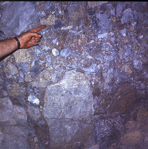 Pyrite replaced fragments along with silicified limestone fragments and a large Bolsa quartzite boulder, in an intrusive breccia 1600 level, Campbell Mine.
