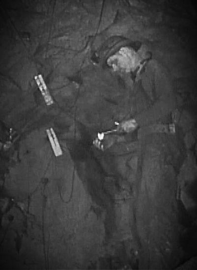 Miner lighting spitter  Junction mine circa 1940's