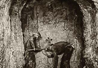 Two miners loading a drift round in the Junction mine.
