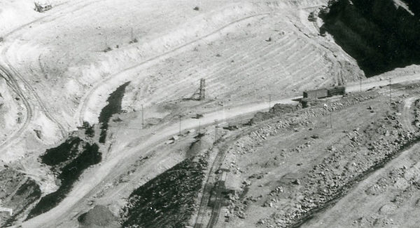 The small headframe of what was likely the Reese Shaft on the edge of the Sacramento Pit. Note the hoist house has already been mined out.