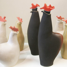 Small rooster and hens