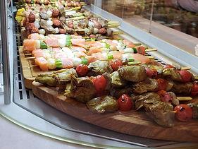 skewers of meat, olives, vegtables