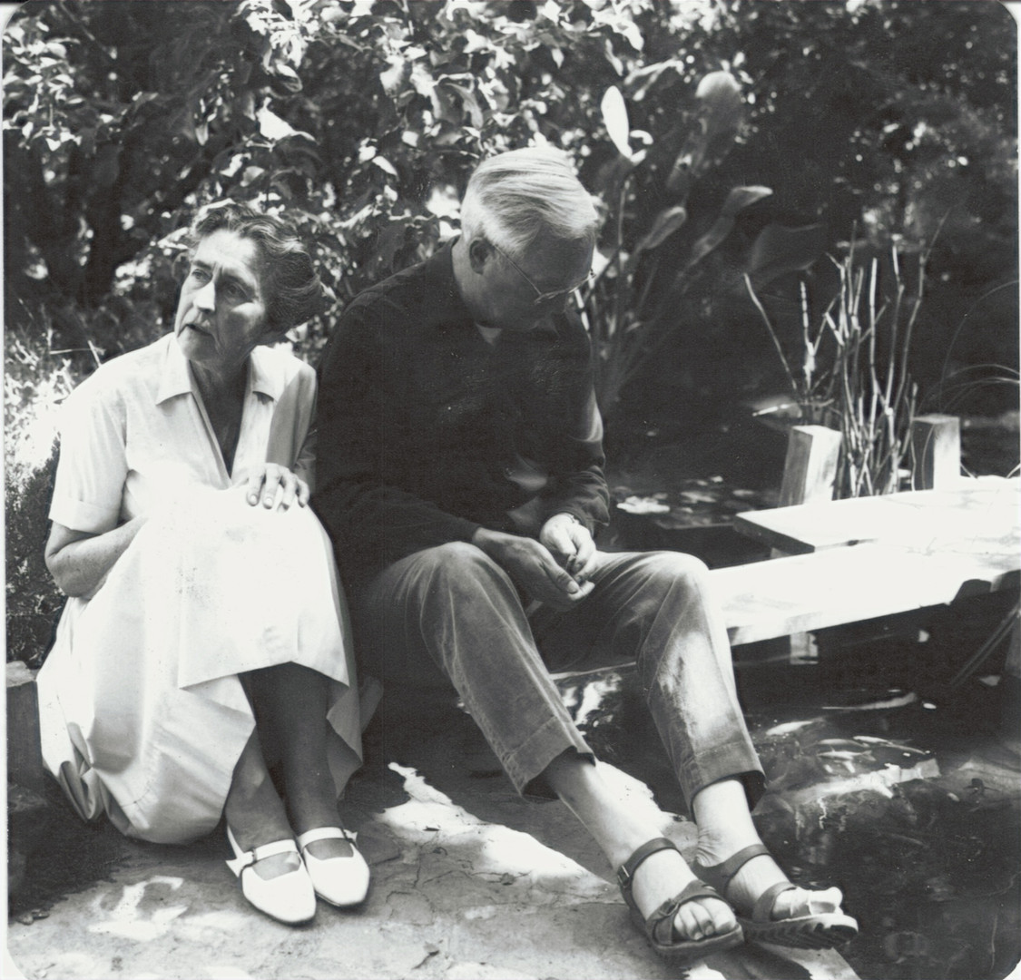 Alan and Helen Hooker by the koi pond.