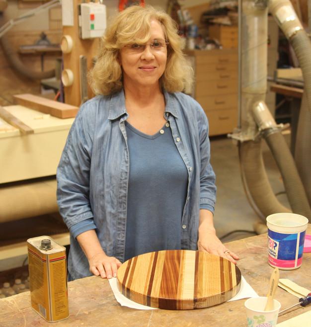 Linda finishing her cutting board