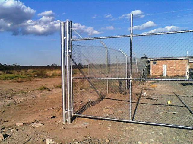 industrial chainwire fencing with barbed wire