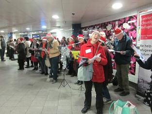 Carol singing for refugees
