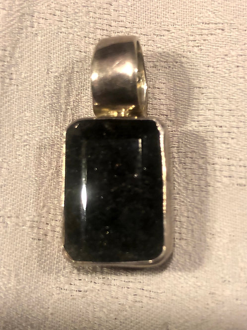 Black tourmaline grown in side the quartz pendant