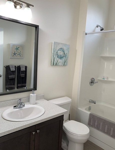 3 piece bathroom with a tub and toilet