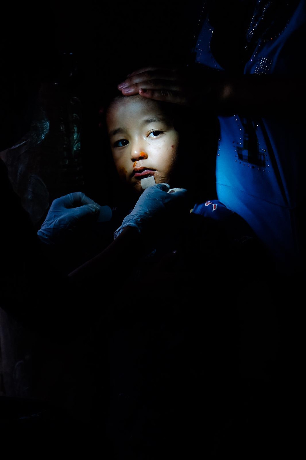 Children face at iluminated in mothers arms