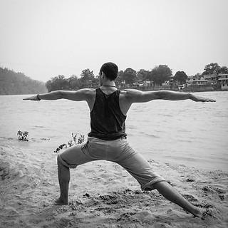 Virabhadrasana II on the Ganga. Rishikesh, India.
