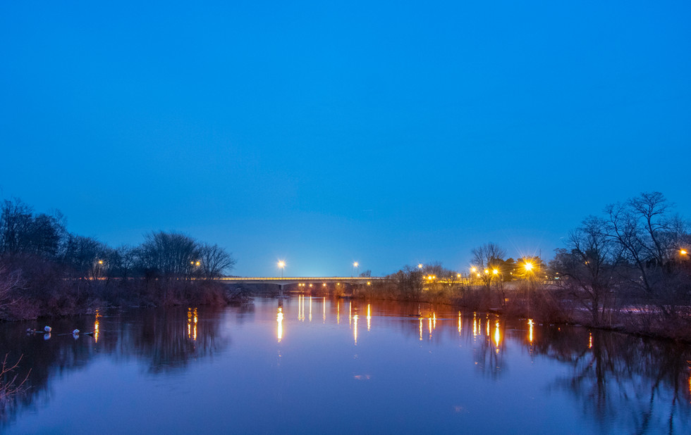 Reflections on the Huron  River. Ann Arbor, Michigan. 03 February 2020, 6:30 P.M.