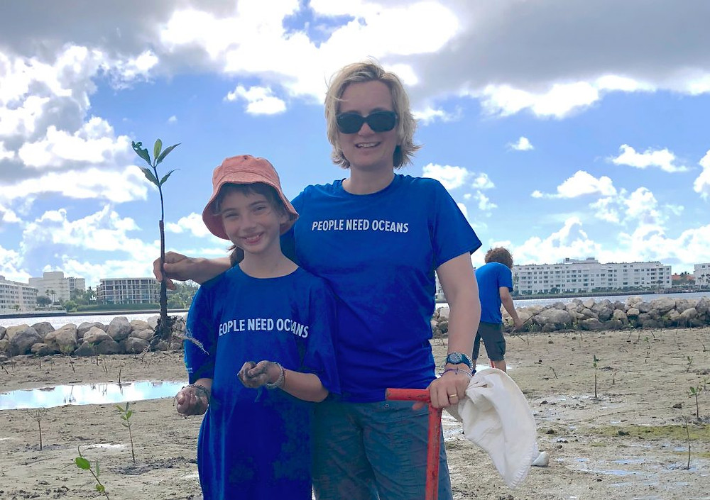 Emily Pidgeon and her daughter, Bronwyn, planting mangroves together in Florida. (Photo courtesy of Emily Pidgeon)