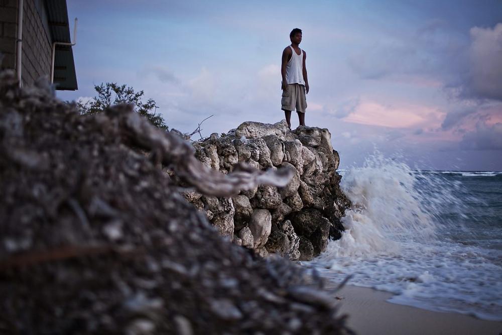 Global sea-level rise threatens homes and livelihoods in Kiribati, an island nation in the Pacific. (© Ciril Jazbec)