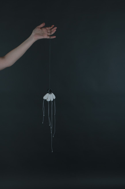 Material Bodies - your body is full of little birds moving in their sleep, porcelain, steel and cotton, 2018.