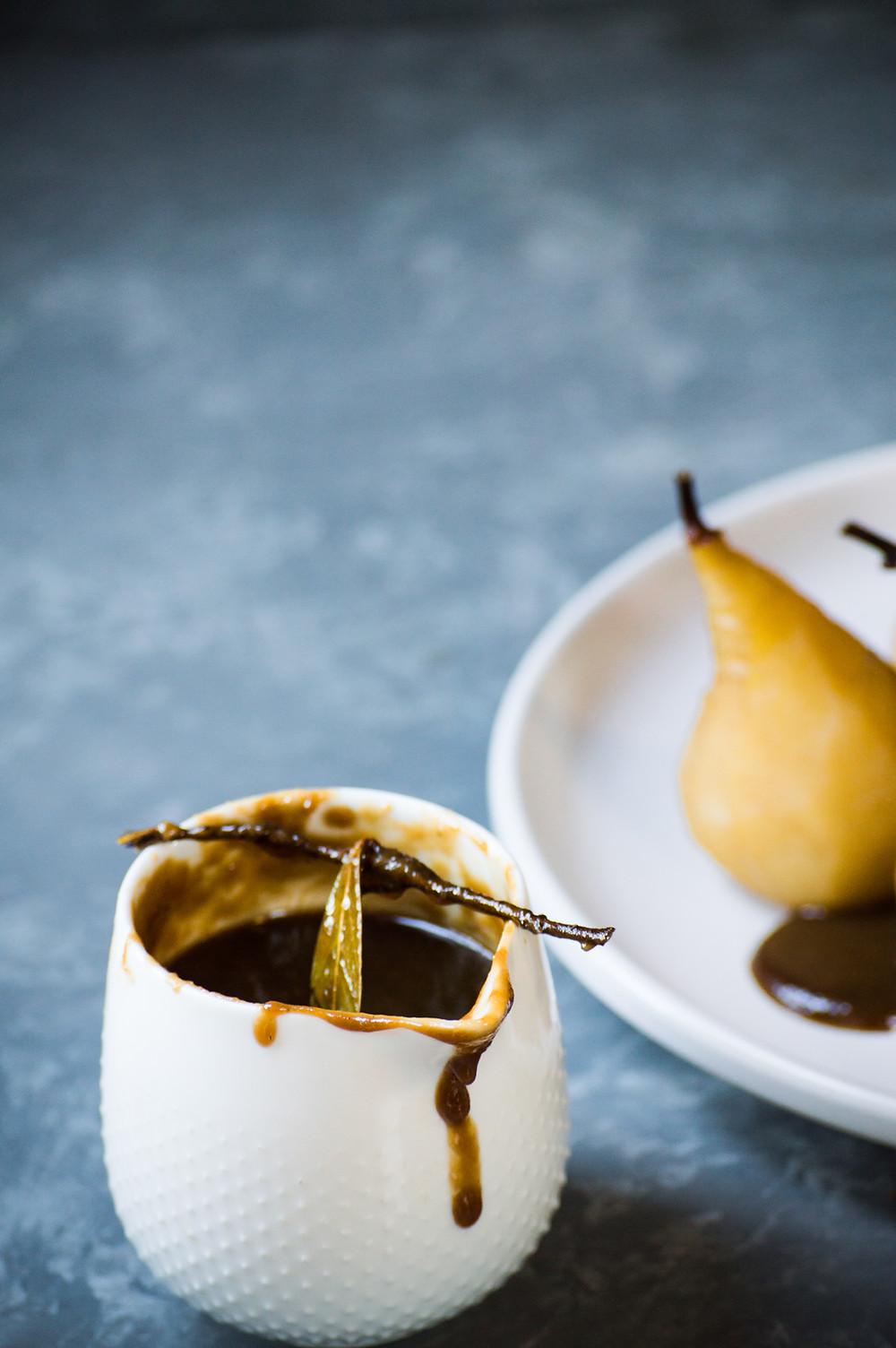 Spiced caramel sauce, poached pears, bay leaf