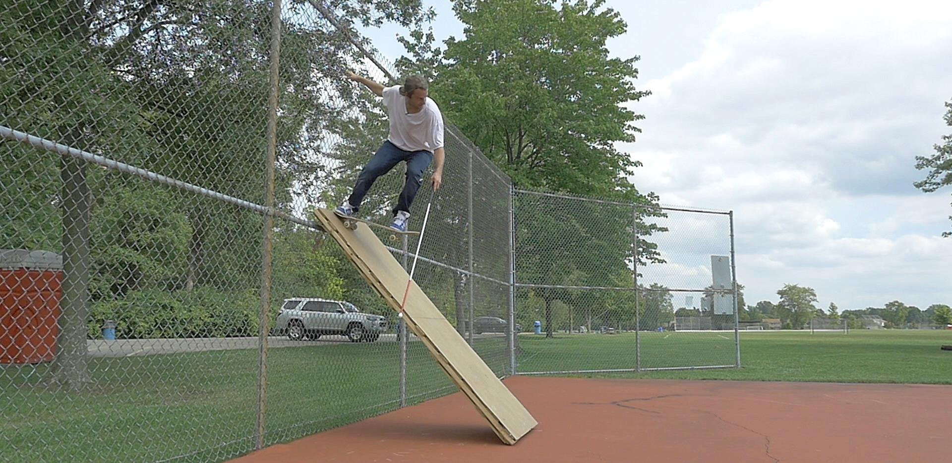 dan mancina dropping in on a makeshift ramp at a park