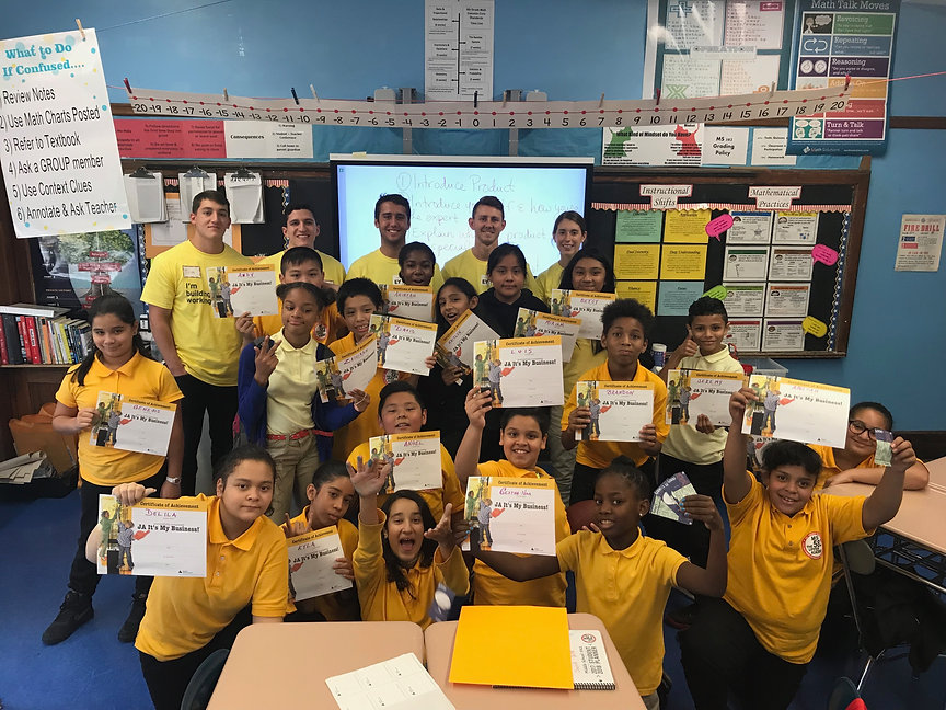 Showing off certificates from junior achievement with Ernst & Young
