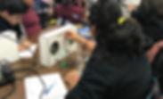 Students testing their boom box circuits
