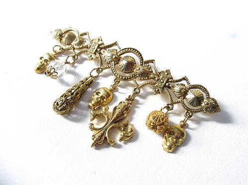 Gold Tone Skull Charm Pin