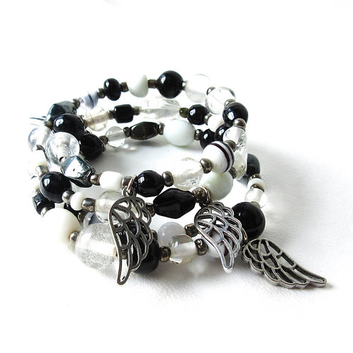 Black and White Beaded Bracelet with Wing Charms
