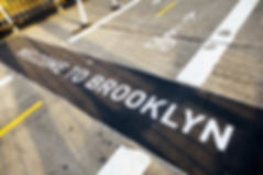 A sign on the floor of the Brooklyn side