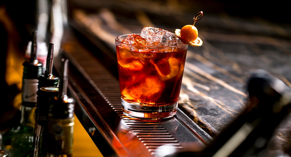 a-cocktail-glass-with-ice-cubes-garnishe