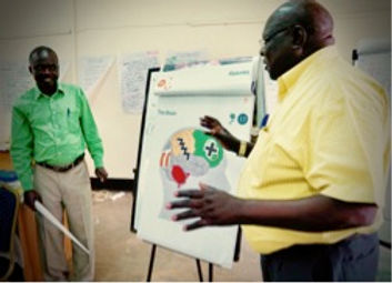 Condition and Oromo explaining the brain.jpg