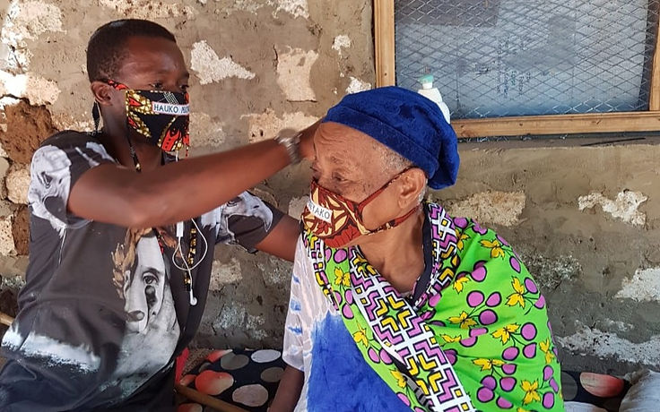 Man%20helping%20elderly%20woman%20with%20mask%20Day%202%20WhatsApp%20Image%202020-07-03%20at%205.35_