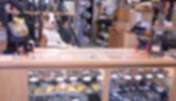 Boomer the Gun Shop dog pistol pup