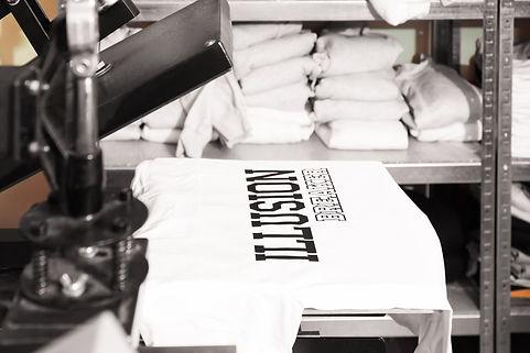 Modern printing machine with t-shirt at