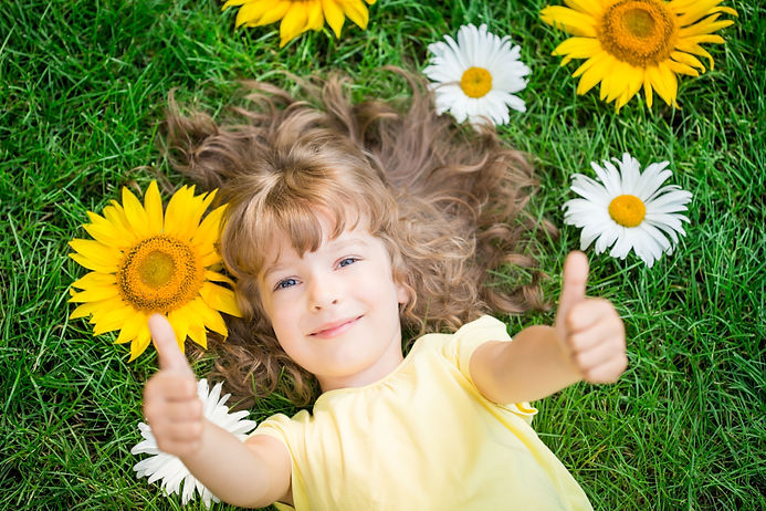 Child lying in sun flowers