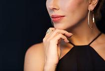 Woman showing off earring