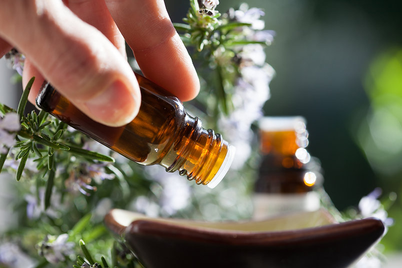 pouring out a drop of essential oils