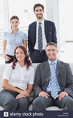 business-team-posing-for-a-photo-E760B3.