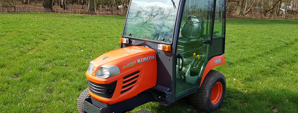 Kubota Compact Tractor BX2350 HST Cab Tractor On Turf Tyres