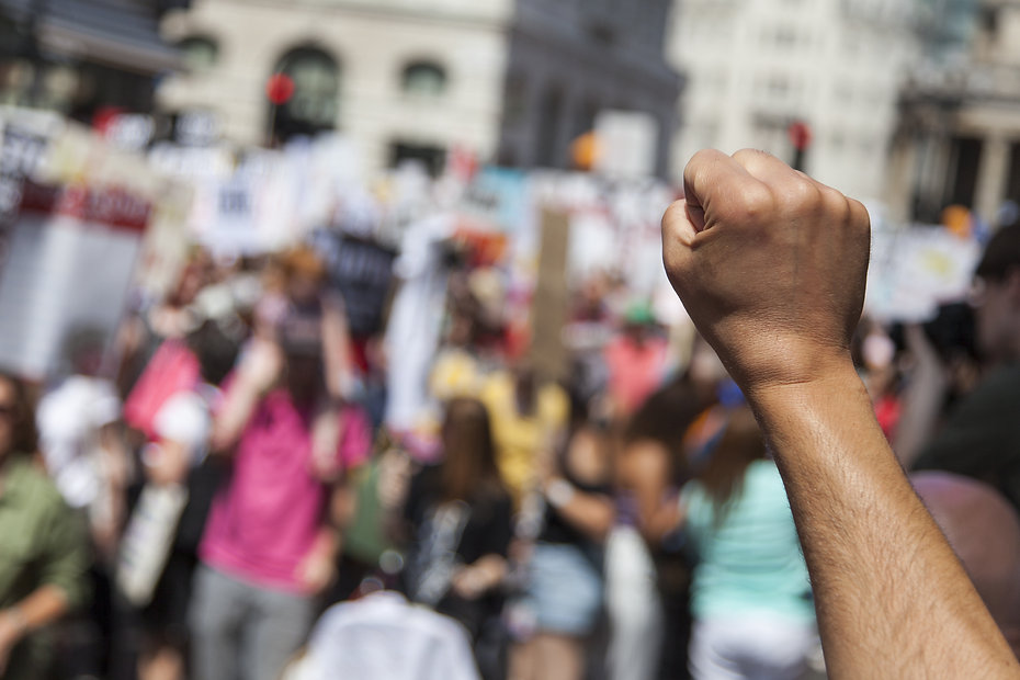 BLACK ARM RAISED IN FIST AT PROTEST.