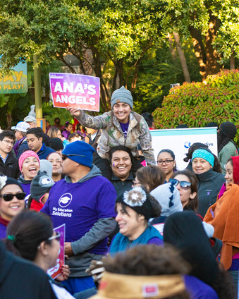 Walk to End Epilepsy participant lifts s