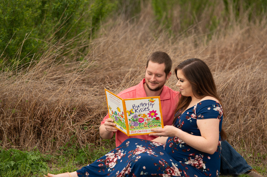 Expecting couple read a children's book