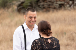 Couple share a laugh at the altar